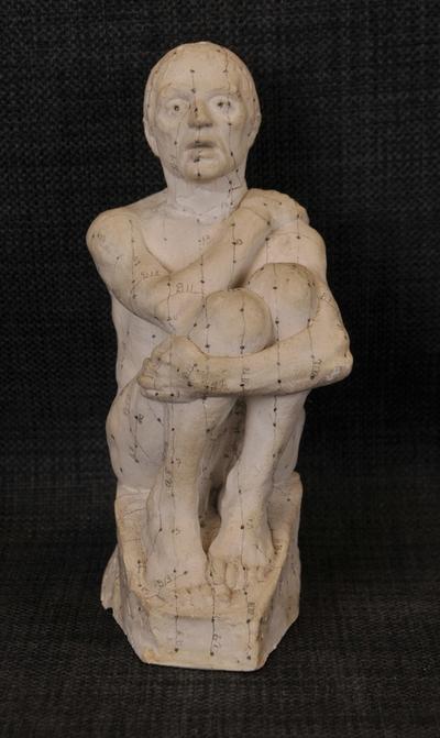 Skulptur av ein ung mann