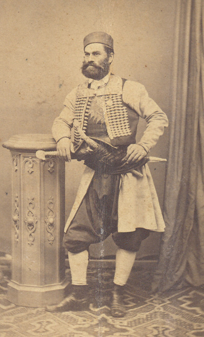Portrait of a poet Jovan Dragasevic in Montenegrin national costume