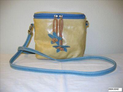 Kleine schoudertas in beige leer met blauwe accenten