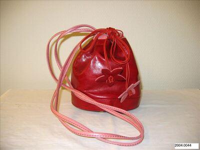 Ronde tas in rood leer met roze accenten