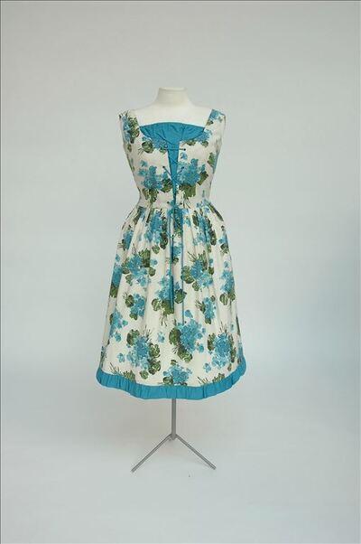 Ecrukleurige open jurk bedrukt met turkoois/groene bloemen