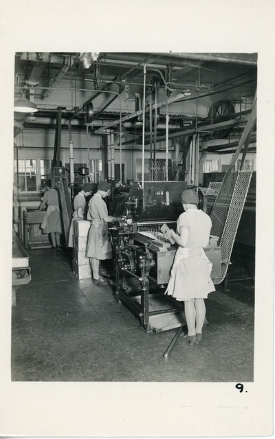Female employees from Aintree working with trays of biscuits