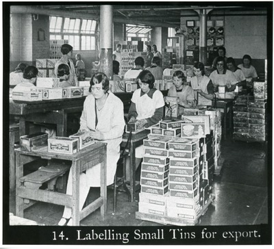 Female workers labelling small tins of Jacob's goods for export