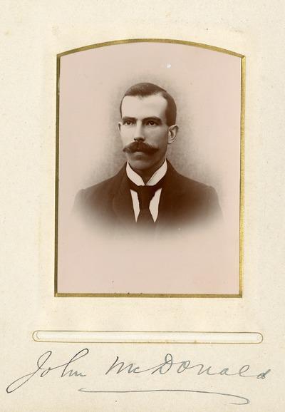 Portrait photograph of John McDonald