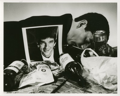 two photographs. one of a man face down with cans and bottles around him and the other of two men. one dressed in a suit and then other dressed scruffily falling asleep.