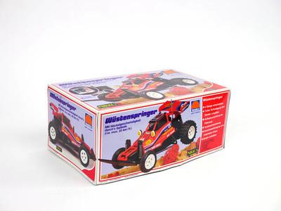 Op afstand bestuurbare auto, rode raceauto, Wüstenspringer in doos