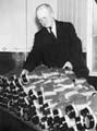 ARP helper sorting gas masks at St Mark's School during World War II.