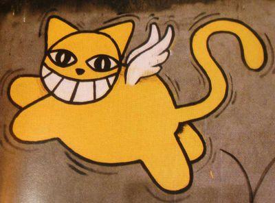 Gatto giallo alato