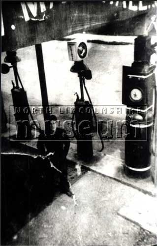 Petrol stand with attendant Albert Harrison, at a garage that stood on Brigg Road, Ashby close to Ashby Ville, c.1938.