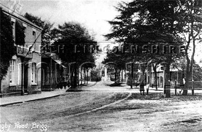 Looking west up Bigby Street, Brigg. On the left is 'Stringer's temperance hotel and the 'Monument' is in the distance