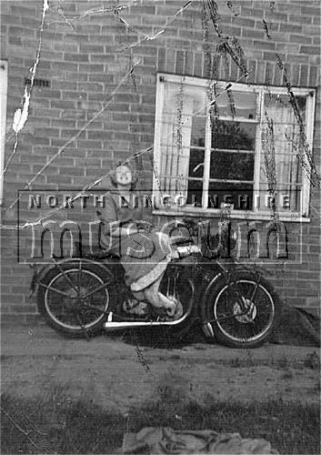 Member of the Smith family of 23 Friars Road, Scunthorpe, taken in their back garden on the Manor Farm Estate, c.1960's