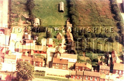 Aerial view of part of Eastoft looking west over the main street in January 1971