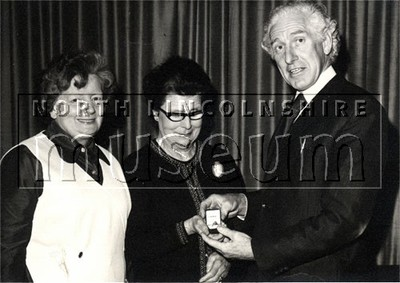 Presentation of jewellry by Mr Alfred 'Biff' Riley to two of Riley's Potato Crisps of Colin Road, Scunthorpe's longest serving employees in the mid 1970's