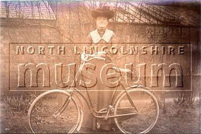 An Edwardian lady proudly photographed with her loop framed bicycle in Scunthorpe