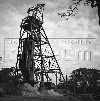 Santon Mining Company record photograph, the finished permanent headgear with the start of the Winder house steel frame in the background, Winn Shaft, 2 November 1939