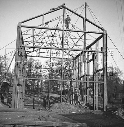 Santon Mining Company record photograph, erection of the steel frame of the Winder House, Winn Shaft in progress, 24 November 1939