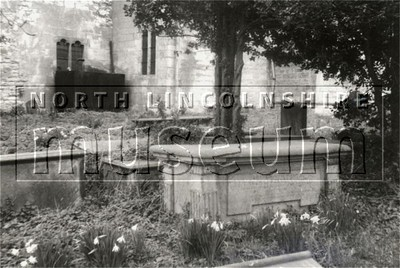 Gravestones in the graveyard of the Parish Church of St. Maurice, Horkstow, south of the church tower, taken in April 1985