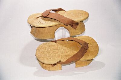 Men's wooden stilted sandals .