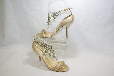 Ladies sandals by Designer Jimmy Choo.