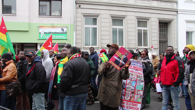 Togolese Protest V – Speech in German and Instructions in French