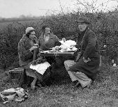 At the Bicester and Warden Hill Point to Point Races near Somerton , Somerset - Mr Hamilton - Snowball eating a picnic with friends . 1932