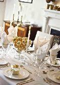 Table laid for Chritmas or a special occasion such as  a Golden wedding party in elegant white dining room  credit: Marie-Louise Avery / thePictureKitchen / TopFoto