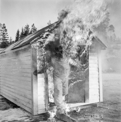 Matti Jämsä experiments with an asbestos outfit in a fire