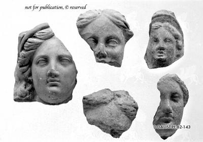 Kopffragment einer weiblichen Terrakottastatuette