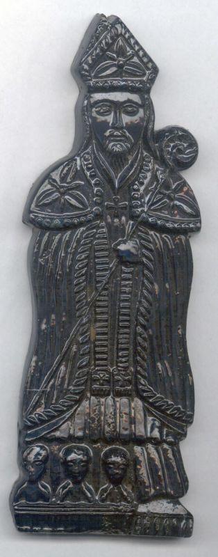 Anoniem, handgemaakt beeldje in vorm van een Sinterklaasfiguur in speculaas, s.d., geverfd gips.