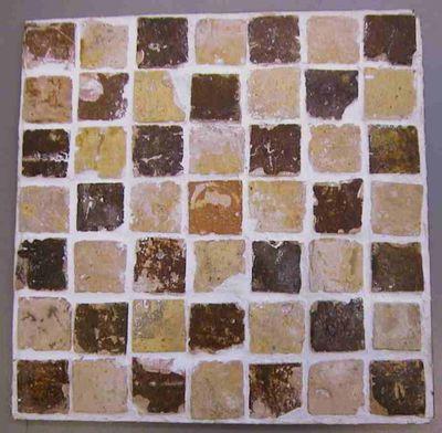 Anoniem, tegelpaneel met 49 13de-eeuwse tegeltjes, afkomstig van de voormalige Herkenrodeabdij, 13de eeuw, keramiek, gips.