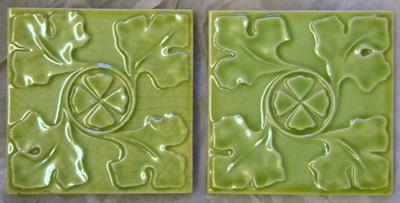Manufacture de Céramiques Décoratives de Hasselt (1895-1954), twee tegels met bladpatroon 'Gambrinus', s.d., keramiek en muntgroen glazuur.