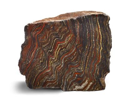 In de vroege atmosfeer van de aarde kwam nog bijna geen zuurstof voor. Het landoppervlak bevatte veel ijzer dat door verwering van het gesteente vrijkwam. Het ijzer werd door rivieren naar zee getransporteerd. Hier produceerden de blauwgroene algen zuurstof als een afvalproduct van de fotosynthese. Het ijzer dat in zeewater terecht kwam, werd door zuurstof geoxideerd tot ijzermineralen als hematiet en magnetiet. De kleine mineraaltjes dwarrelden neer en vormde kleine laagjes op de zeebodem.