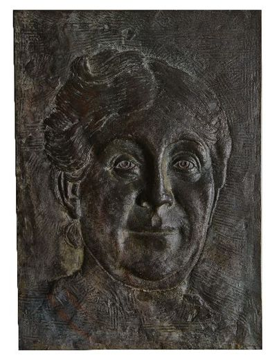 Bronzen reliëf. Wilhelmina Drucker.