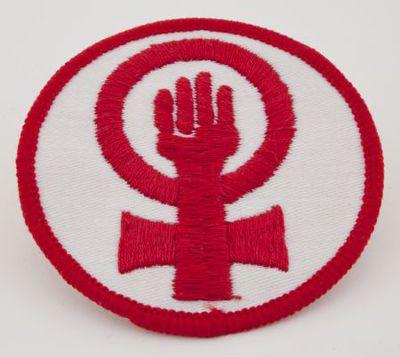 Insigne. Vuist in vrouwenteken