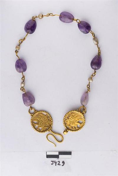 Department of Antiquities Republic of Cyprus: Necklace with pearls threaded on small pieces of gold wire (J. 429)