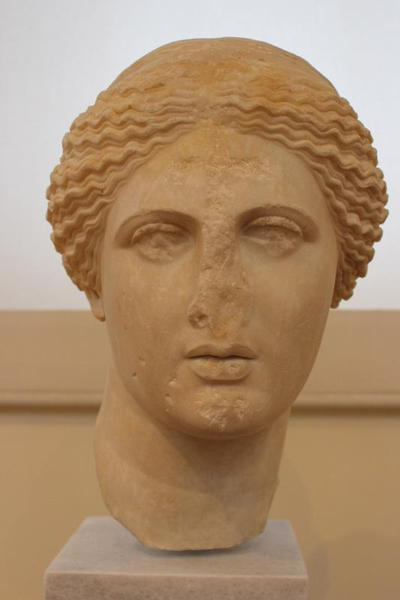 Head of Aphrodite; Cross carved on the forehead; eyes, nose, chin and lips chipped. Athens Archaeological Museum, Greece