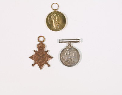War Service medal, Victory medal and 1915 medal given to Thomas McDonald