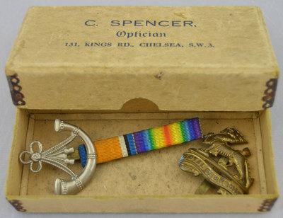 Boxed regimental insignia badges