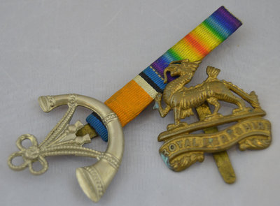 Regimental insignia badges for the Berkshire Regiment and the Oxford and Buckinghamshire Light Infantry