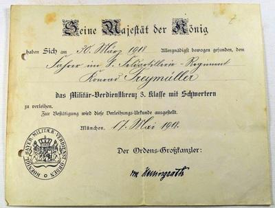 Verdienstkreuz-Urkunde und Reservistenkrug von Konrad Freymüller