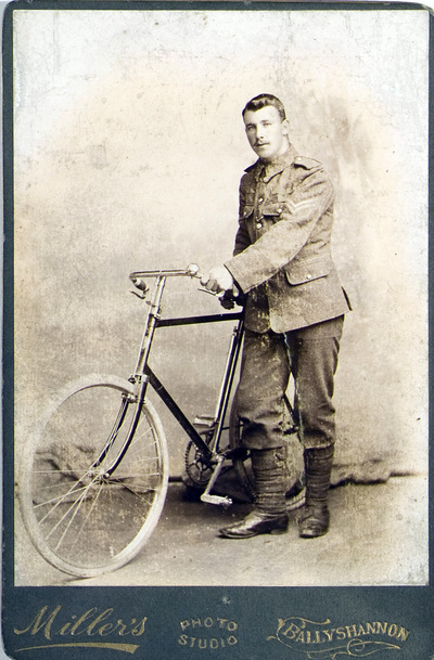 Photograph of Joseph Phillips, with bicycle
