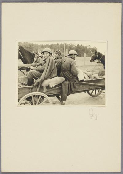 Polnische Kriegsgefangene auf Fuhrwerk