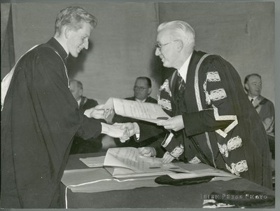 Photograph of Michael Tierney and a young priest at a conferring ceremony at St. Patrick's College, Maynooth.