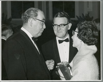Photograph of reception and presentation on Michael Tierney's retirement as President of UCD : Bob O'Connell, unidentified man and Catherine A. Crawley.