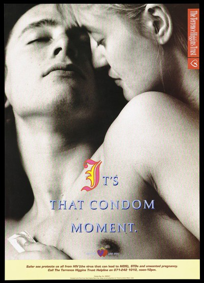 A naked couple embracing; man holds condom; an advert for safe sex by the Terrence Higgins Trust. Colour