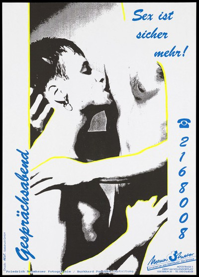 A man with an earring kissing the nipple of another man standing representing an advertisment for safe sex services provided by Mannometer, the helpline for gay men in Germany to prevent AIDS. Colour lithograph by Friedrich Baumhauer and Burkhard Paschke.