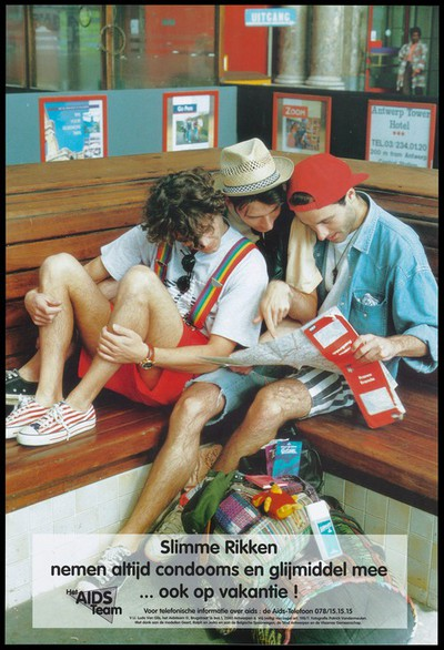 Three gay men sit on a corner bench in Antwerp train station wearing shorts, hats and pumps looking at a map of France with their luggage beside them; amongst their luggage are lubricant and condom packs; an advertisement for safe gay sex by the AIDS team in Antwerp. Colour lithograph by Patrick Vandermeulen, ca. 1990's.