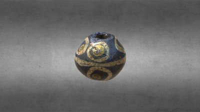 Blue glass bead with 'eye' decoration, T 051
