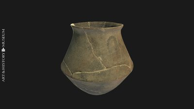Carinated vase with round base and flaring rim