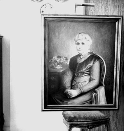Tavla, oljemålning. Motiv: sittande kvinna. Kapten Oscar J. Eriksson
